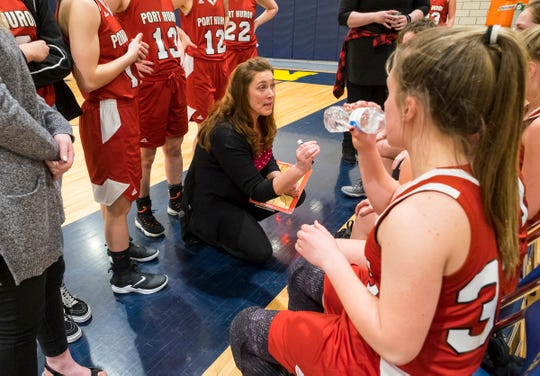Port Huron High School head coach Becky Gilbert addresses the team between periods of an MAC tournament basketball game Thursday, Feb. 14, 2019 at Port Huron Northern High School.
