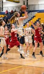 Port Huron Northern's Ally Shagena (21) shoots the ball during an MAC tournament basketball game against Port Huron High School Thursday, Feb. 14, 2019 at Port Huron Northern High School.