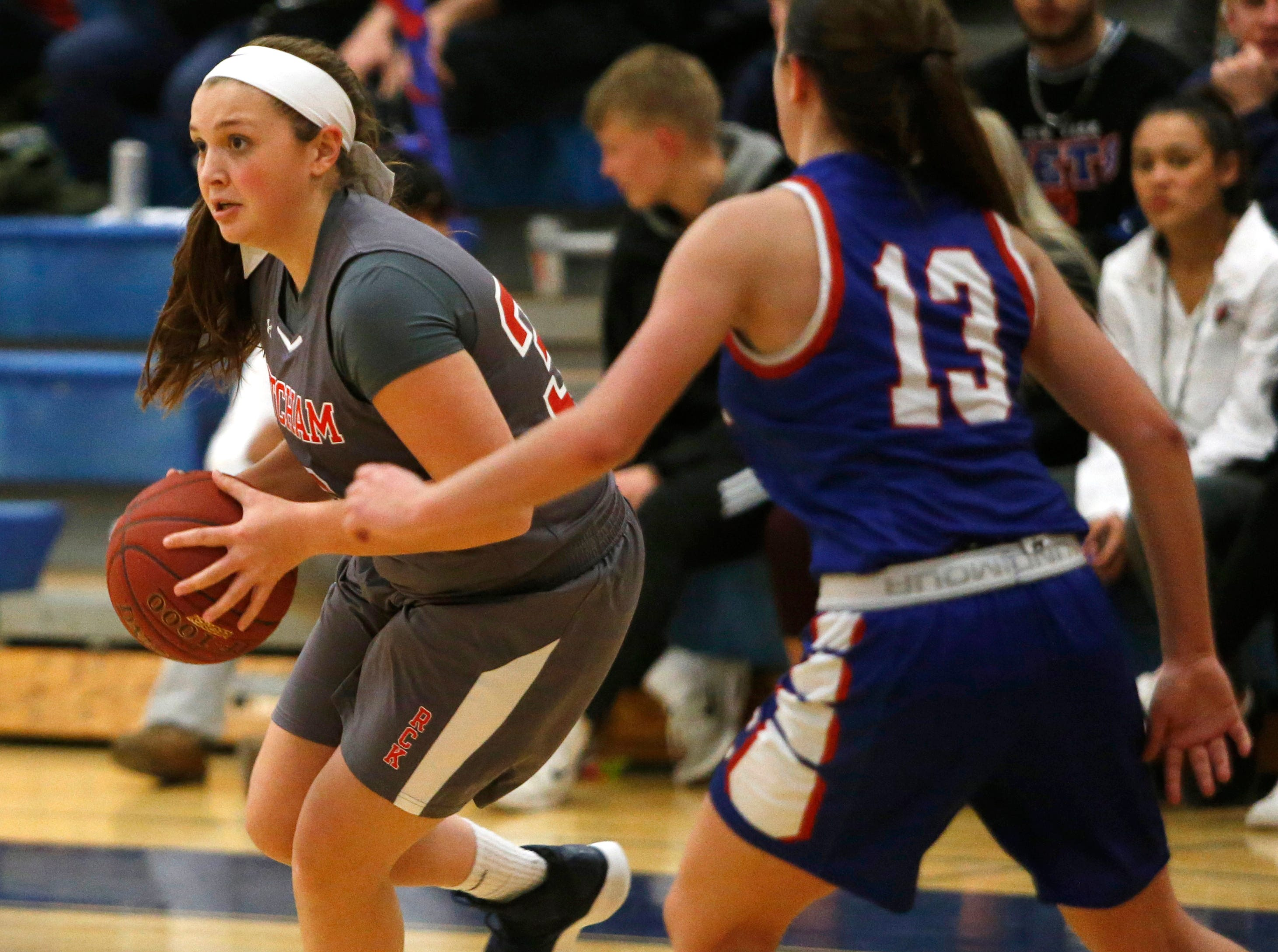 Ketcham's Kayla Howley clears Carmel's Danielle Bello during Thursday's game on February 14, 2019.