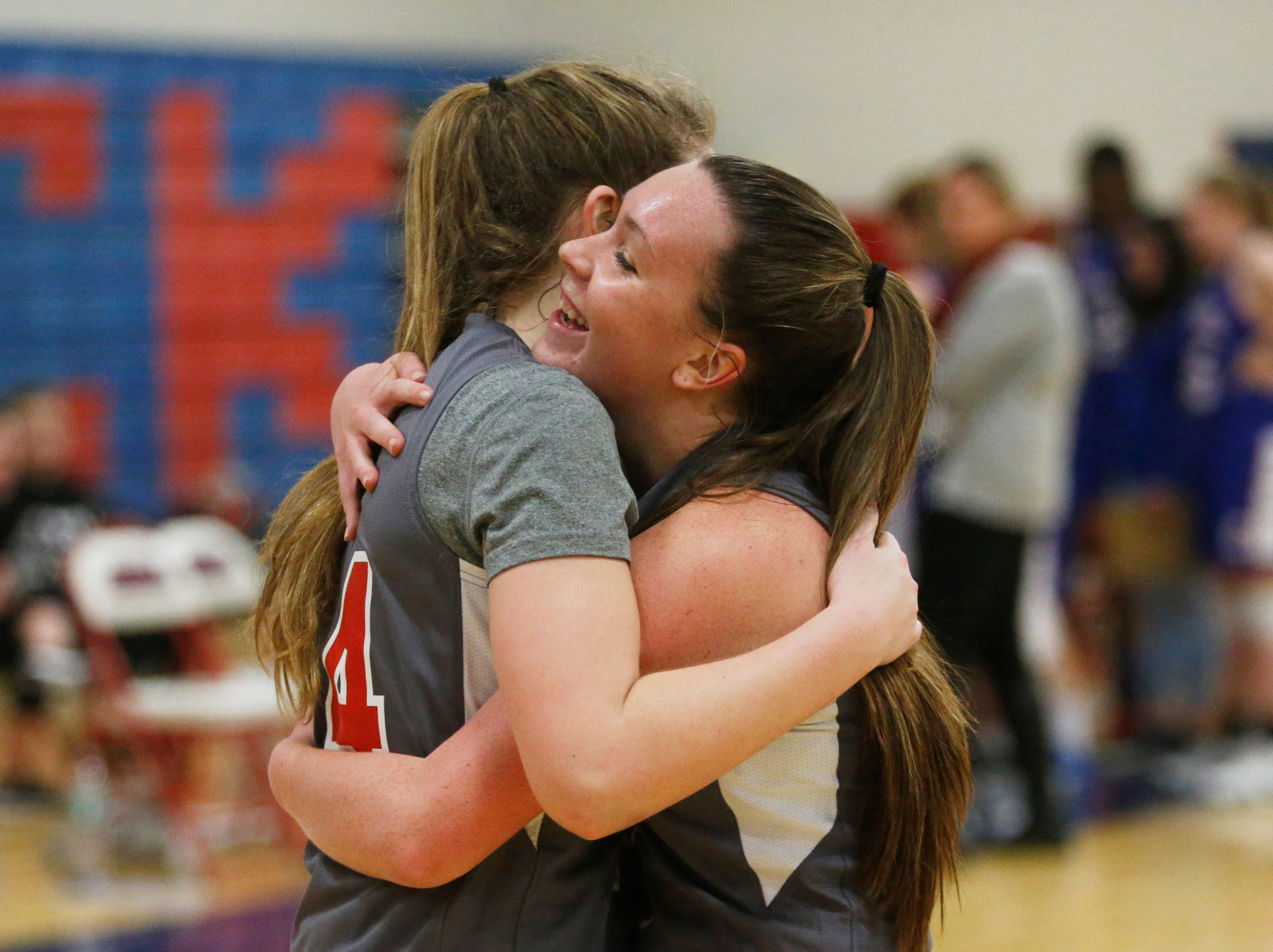 Ketcham's Katie Wall celebrates her 2000th point with Meg Nardelli during Thursday's game on February 14, 2019.