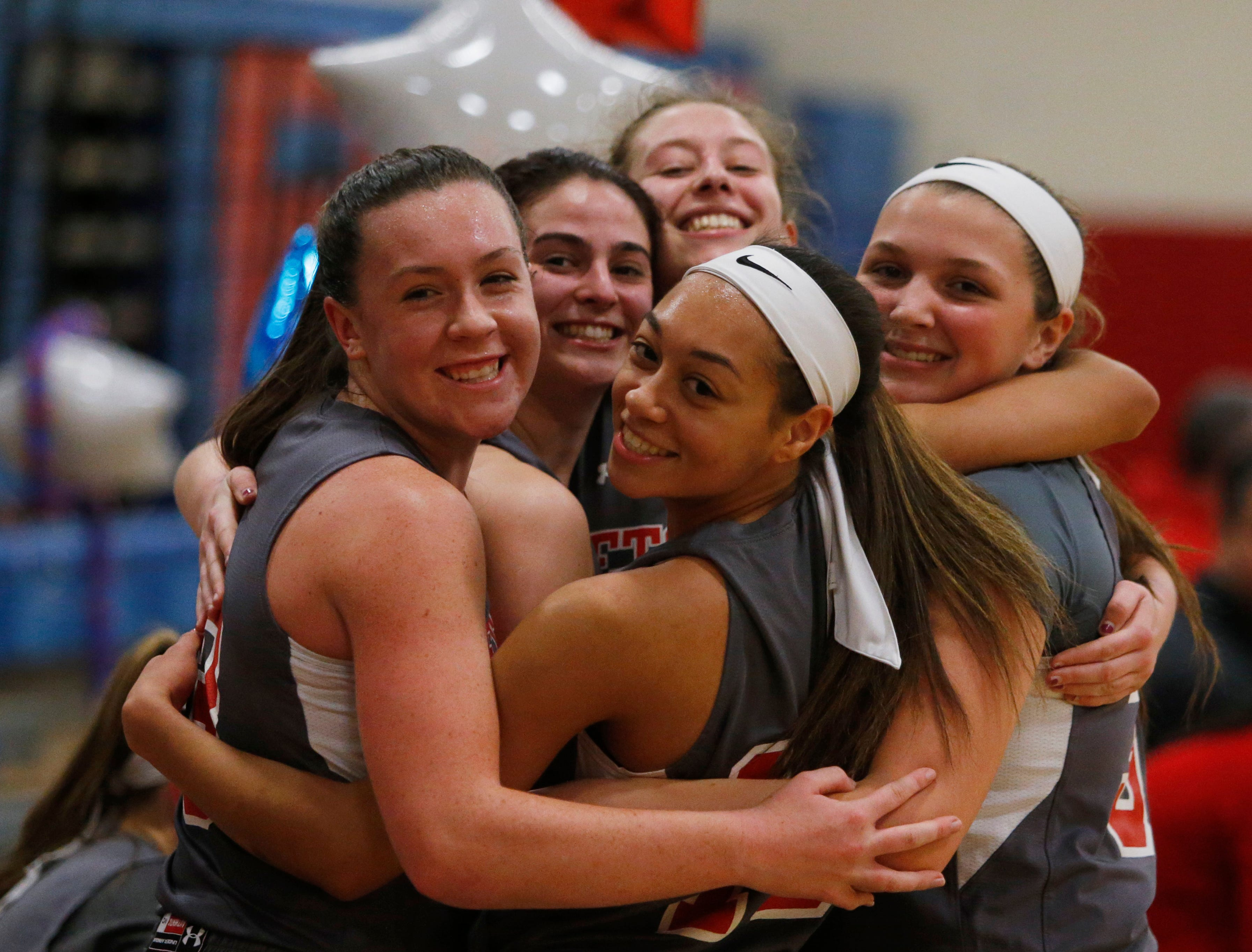 Katie Wall is congratulated by her Roy C. Ketcham girls basketball teammates after notching her 2,000th career point on Thursday.