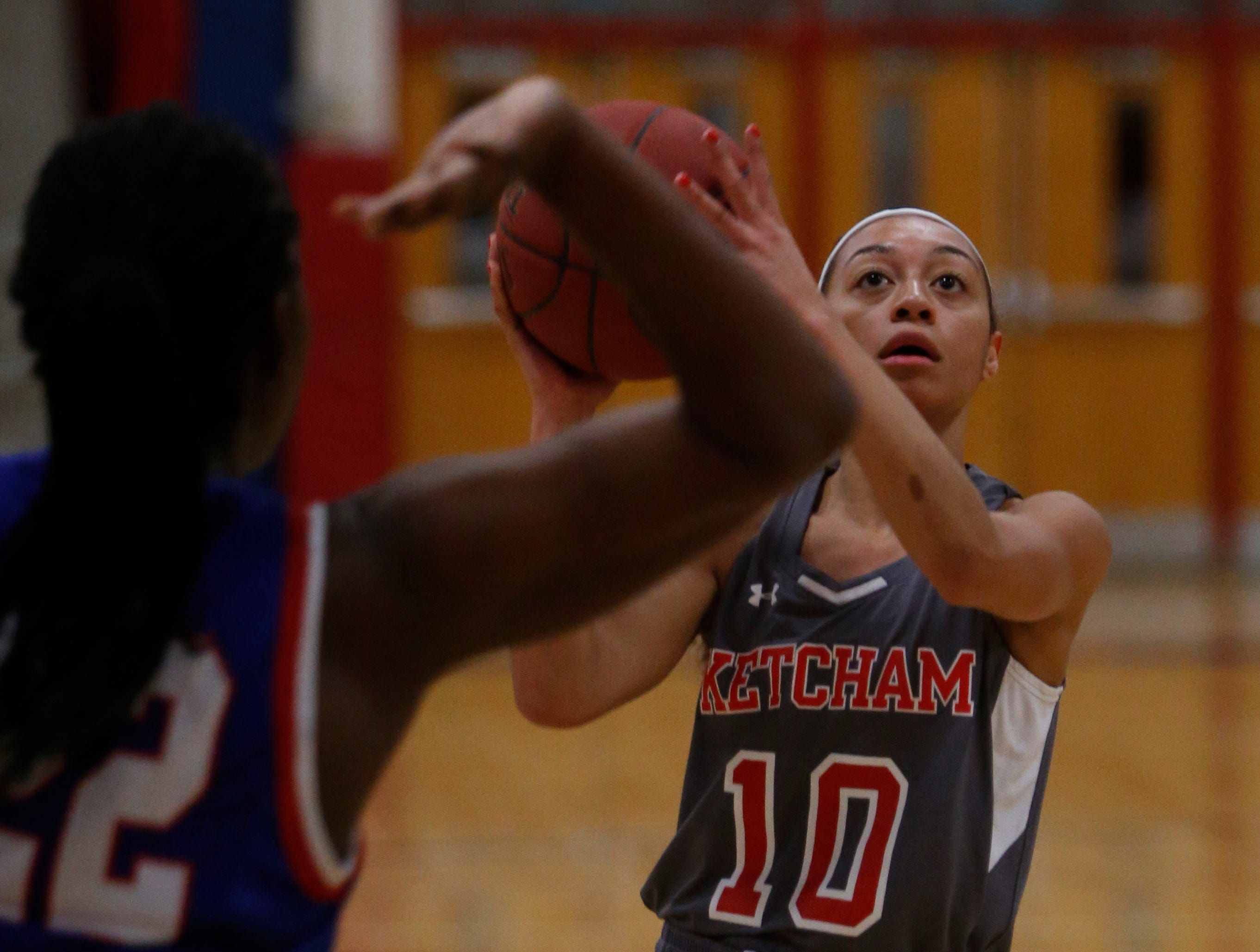 Ketcham's Mya Smith goes for a shot against Carmel's Stephanie Ogbebar during Thursday's game on February 14, 2019.