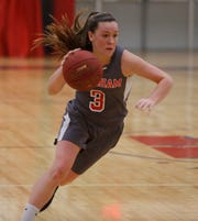 Ketcham's Katie Wall drives up court during a Feb. 14 game against Carmel. The senior scored her 2,000th career point in the game.