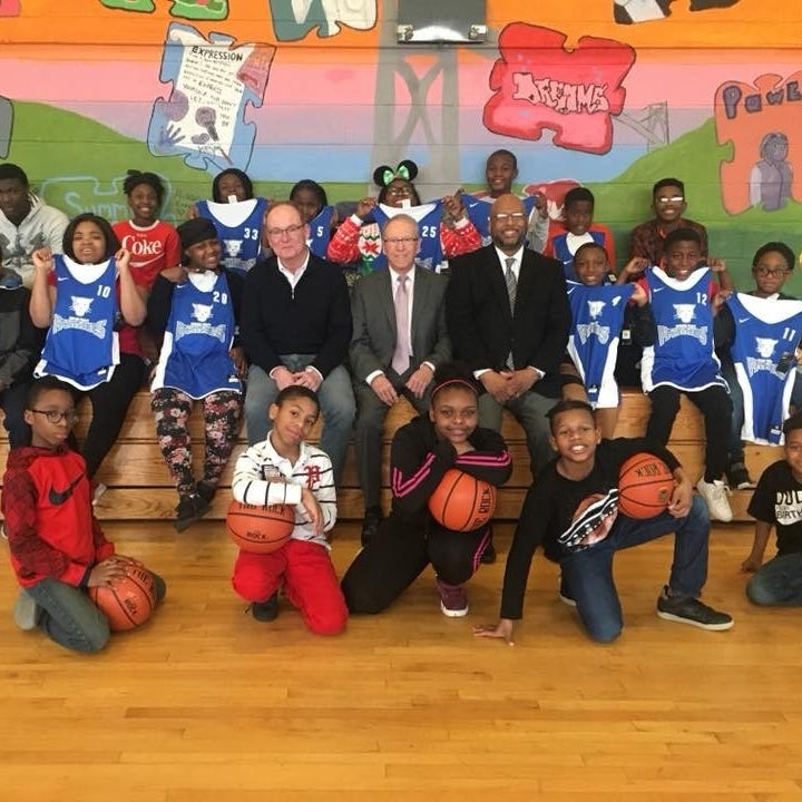 From center left: City of Poughkeepsie Mayor Rob Rolison (black shirt), Dutchess County District Attorney William Grady (dark gray suit) and Boys & Girls Club Executive Director Kevin White (black suit jacket) during a recent visit to the Boys & Girls Club of Poughkeepsie for a tour of the STAR Project at the New Hope Community Center. At far left is Gary Leigh, chief investigator of the Dutchess County District Attorney's Office.