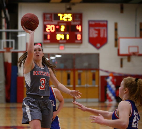 Ketcham's Katie Wall takes a layup during Thursday's game versus Carmel on February 14, 2019. Katie scored her 2000th point during the game.