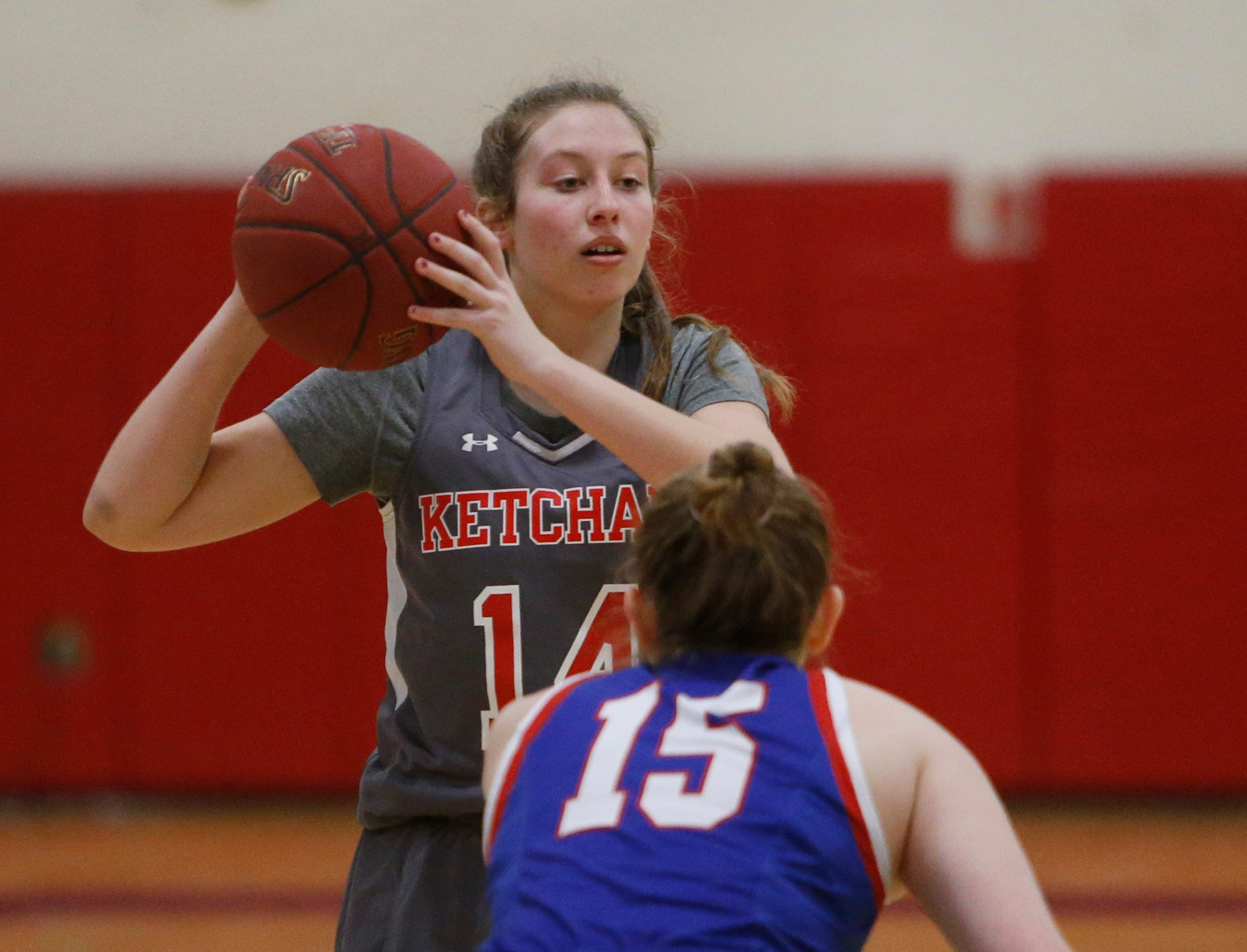 Ketcham's Meg Nardelli looks to pass the ball as Carmel's Claire Cody covers her during Thursday's game on February 14, 2019.