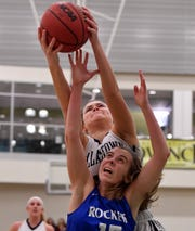 Dallastown's Samantha Miller goes over the back of Lexi Hoffman of Spring Grove for a rebound during the York-Adams basketball final, Thursday, February 14, 2019.John A. Pavoncello photo
