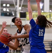 Dallastown's Aniya Matthews looks for an opening while being covered by Ellie Glass of Spring Grove during the York-Adams basketball final, Thursday, February 14, 2019.John A. Pavoncello photo