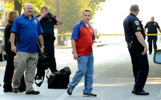 Investigators gather at the scene of a fatal shooting in the 300 block of West King St. Monday, August 18, 2014. Bill Kalina - bkalina@yorkdispatch.com