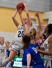 Dallastown's Lily Jamison drives for two against Spring Grove during the York-Adams basketball final, Thursday, February 14, 2019.