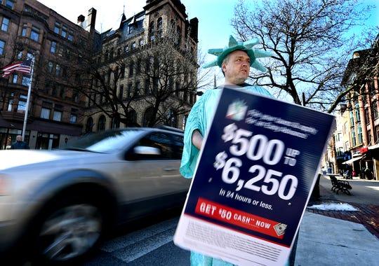 Liberty Tax sign walker Robert Trotta works at Continental Square Friday, Feb. 15, 2019. Bill Kalina photo