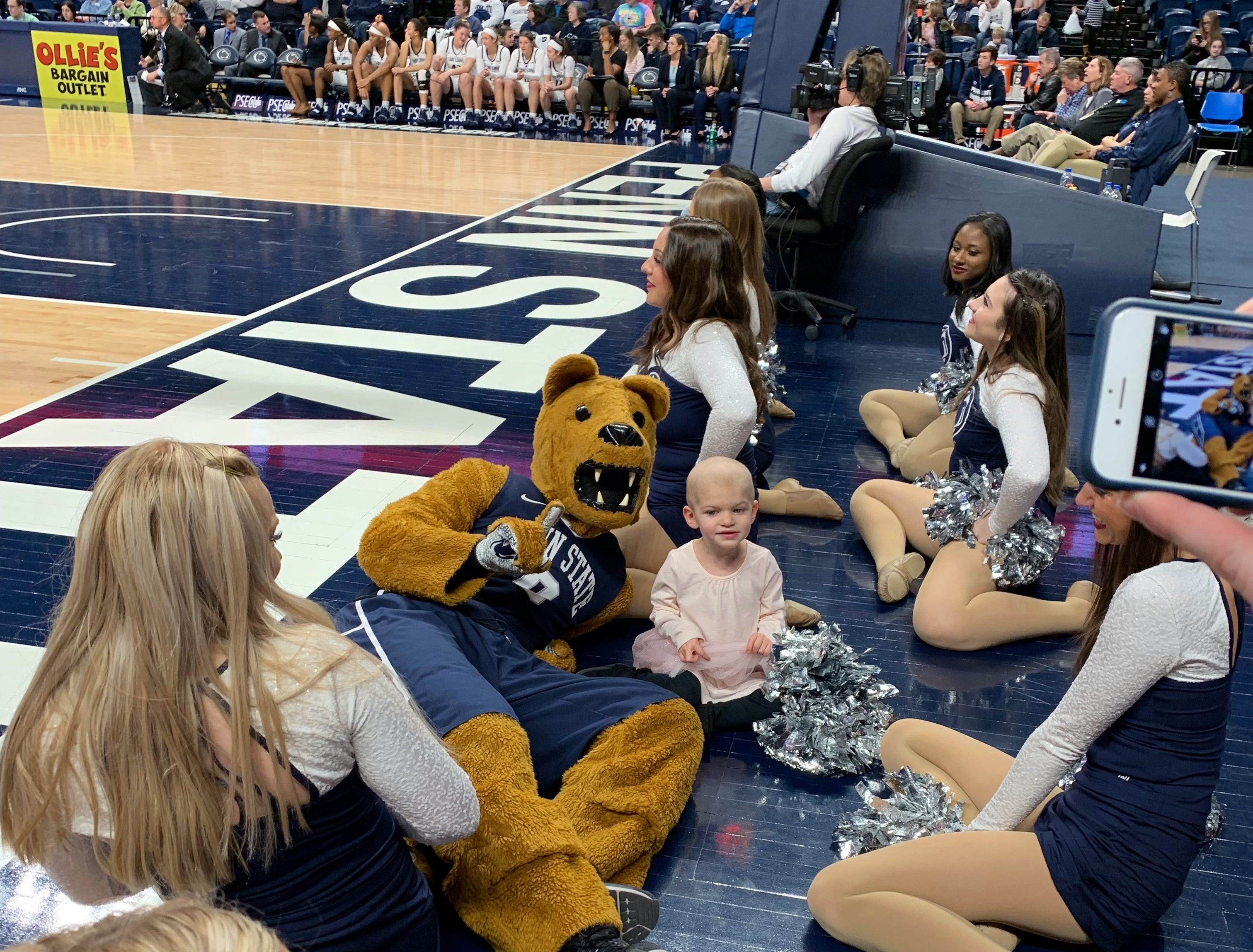 Shiloh poses with the Nittany Lion at a Penn State basketball game, January 12, 2019.