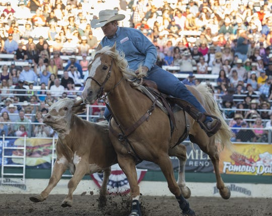 Action the Steer Wrestling event during the Reno Rodeo on June 23, 2018.