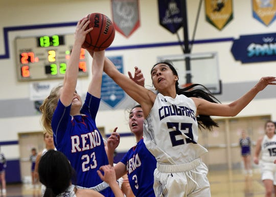 Reno's Tessa Zeigler and Spanish Spring's Serena Sanchez reach for a rebound during Tuesday's game at Spanish Springs.