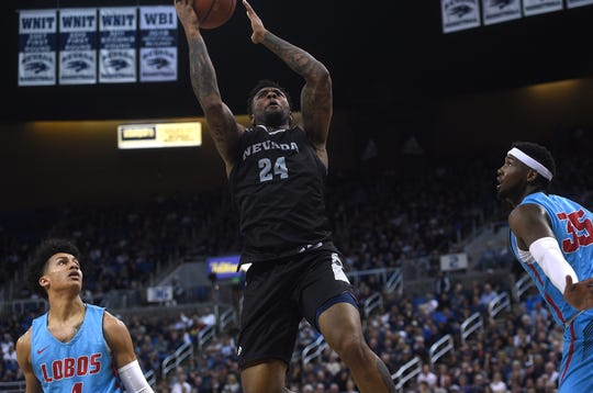 Nevada's Jordan Caroline shoots while taking on New Mexico at Lawlor Events Center in Reno on Feb. 9, 2019.