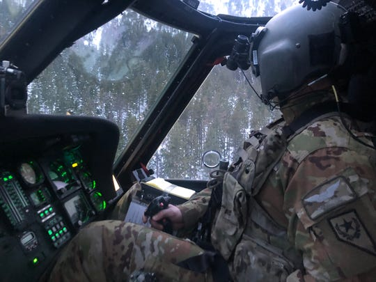 A Nevada National Guard Pilot maneuvers a Black Hawk helicopter during a rescue on Feb. 12, 2019, near Jobs Peak overlooking the Carson Valley.
