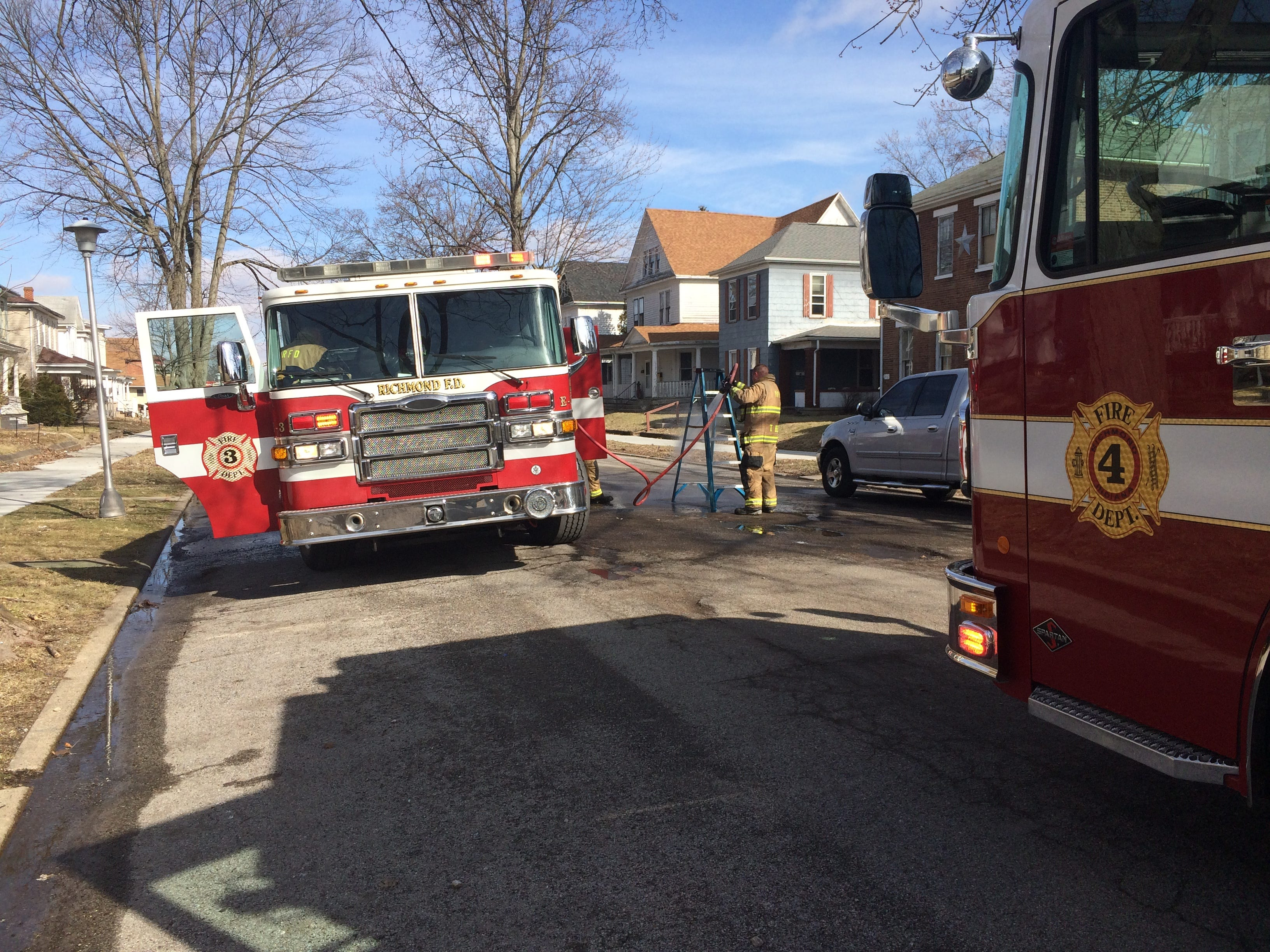 Richmond Fire Department personnel clean and store equipment used to extinguish an apartment fire Friday morning on South 12th Street.