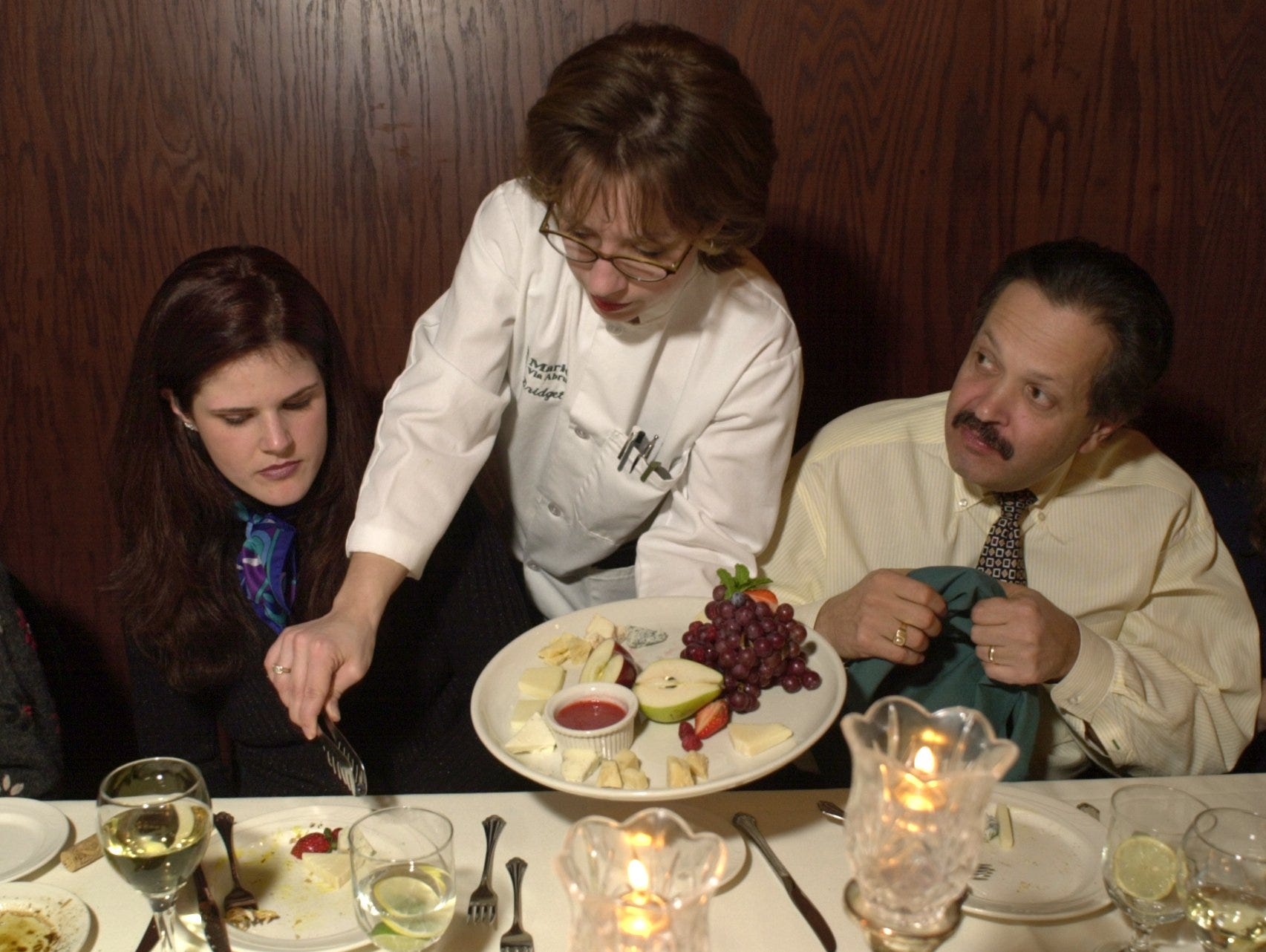Mario's Via Abruzzi server Bridget Bridsom, center, serves the cheese course to Susan Prinzing. left, and Allen Bernstein in 2001.