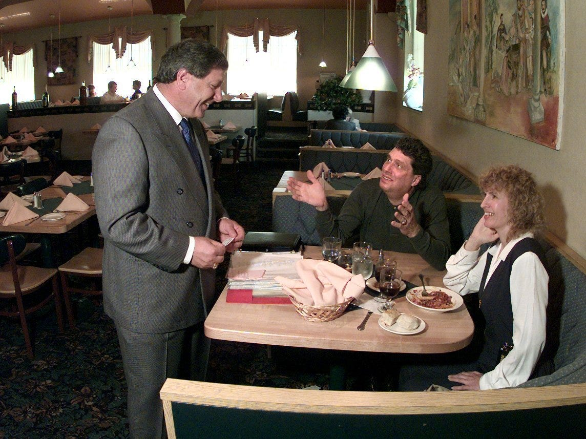 Mario Daniele chats with diners Peter Finch and Ruth Rosenberg-Naparsteck at Mario's in 1997.