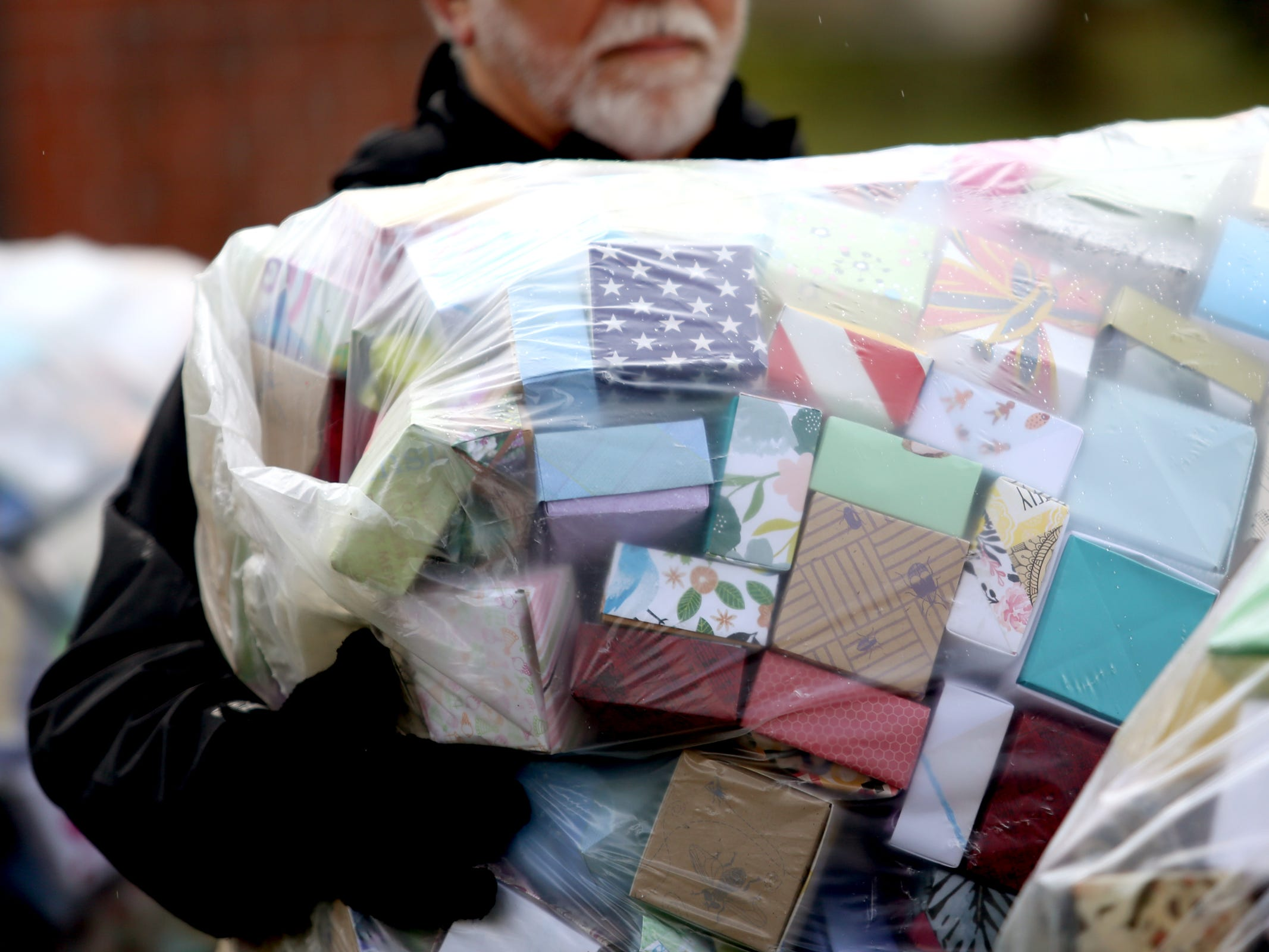 More than 100 people deliver and display more than 37,000 handmade origami boxes, representing victims of gun violence, at the Oregon State Capitol in Salem on Friday, Feb. 15, 2019. The Soul Box Project, started by Portland artist Leslie Lee, aims to reveal the enormity of the gun fire epidemic.