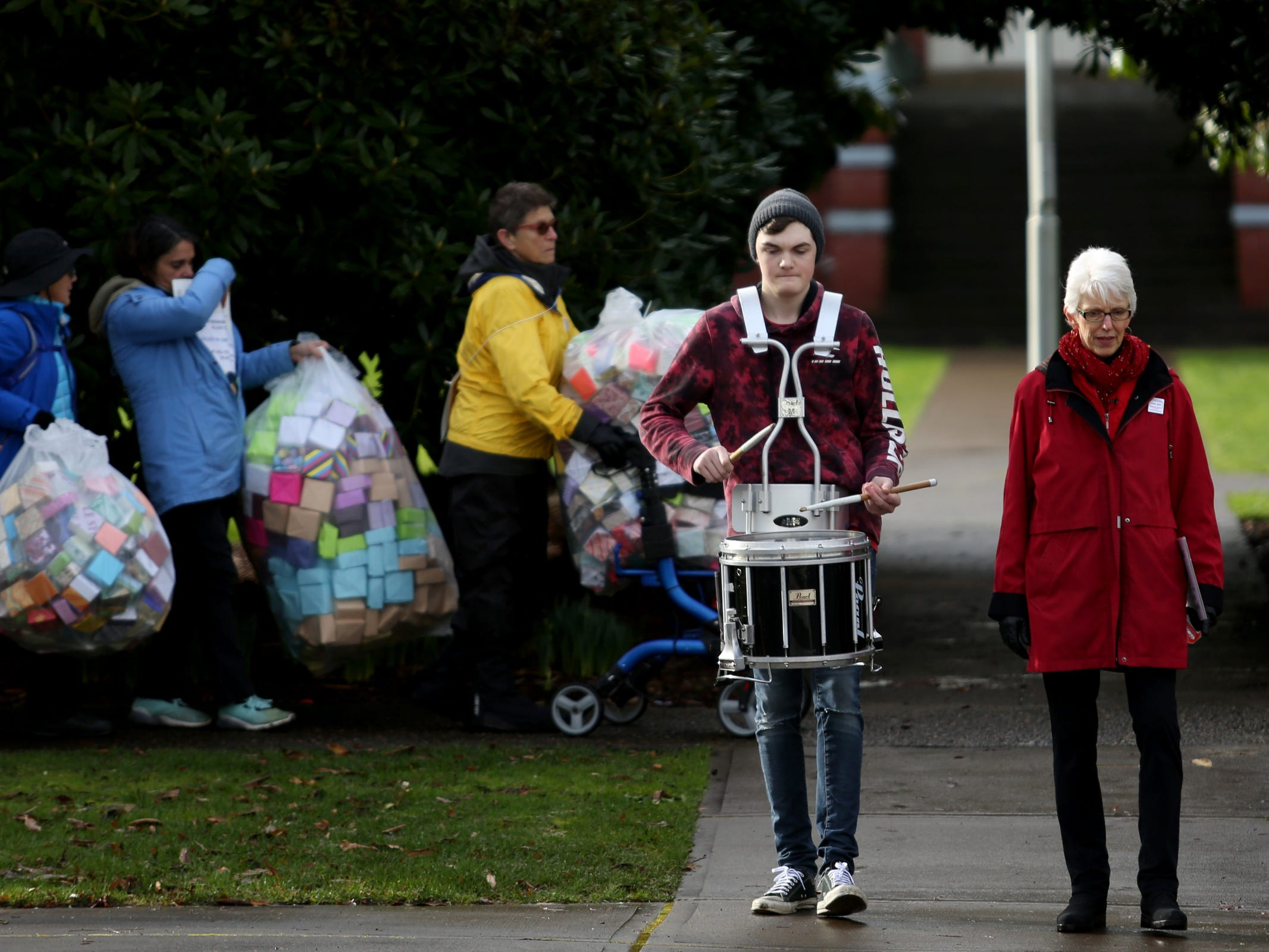 More than 100 people, led by drummer Tristan Kruger and artist Leslie Lee, deliver and display more than 37,000 handmade origami boxes, representing victims of gun violence, at the Oregon State Capitol in Salem on Friday, Feb. 15, 2019. The Soul Box Project, started by Portland artist Leslie Lee, aims to reveal the enormity of the gun fire epidemic.