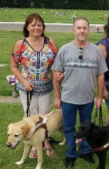 Connie and Stephen Murphy with their guide dogs, Walker and Amelia