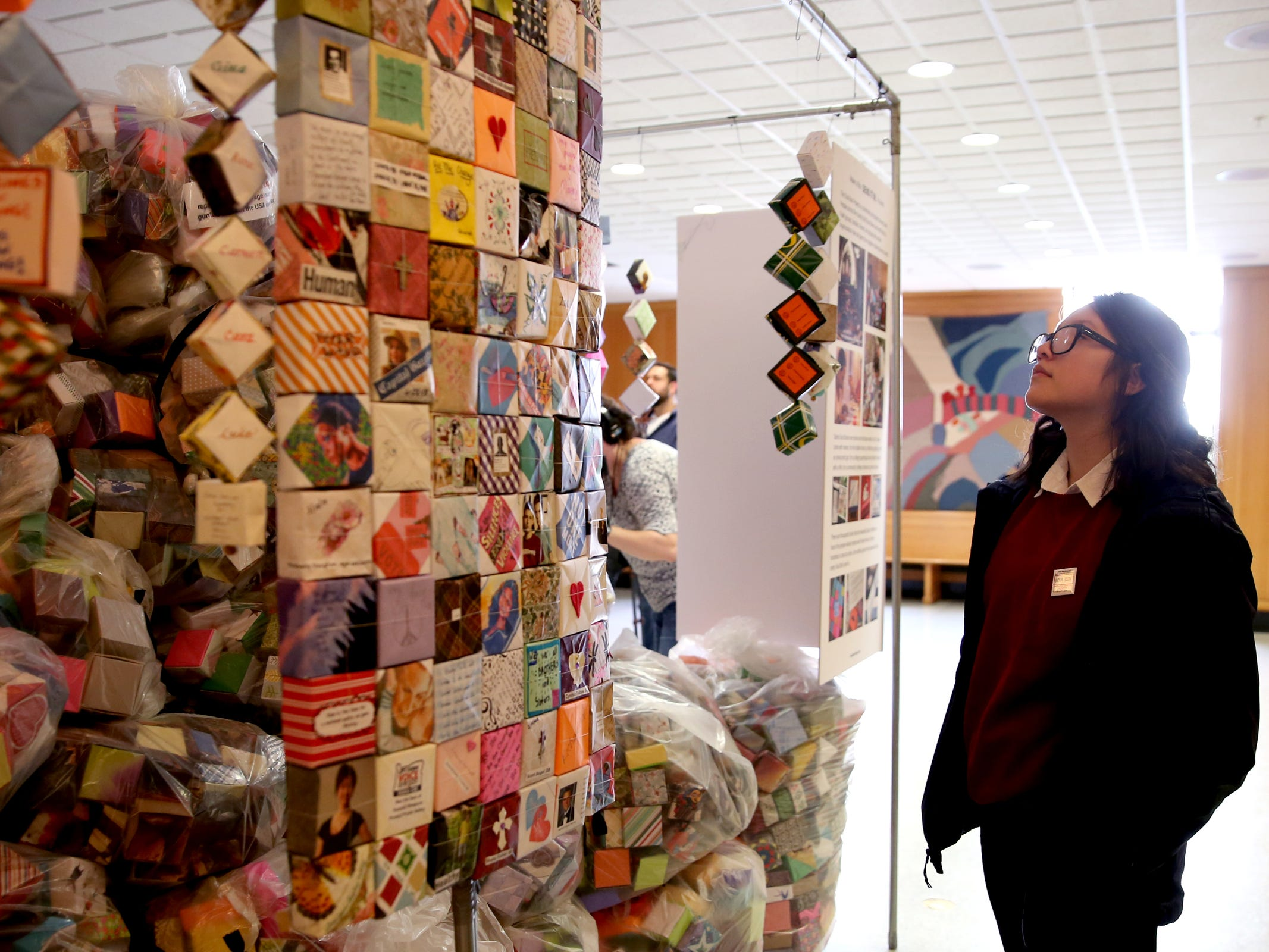 Alejandra Nu–ez, 14, of Hillsboro, looks over the more than 37,000 handmade origami boxes, representing victims of gun violence, displayed at the Oregon State Capitol in Salem on Friday, Feb. 15, 2019. The Soul Box Project, started by Portland artist Leslie Lee, aims to reveal the enormity of the gun fire epidemic.