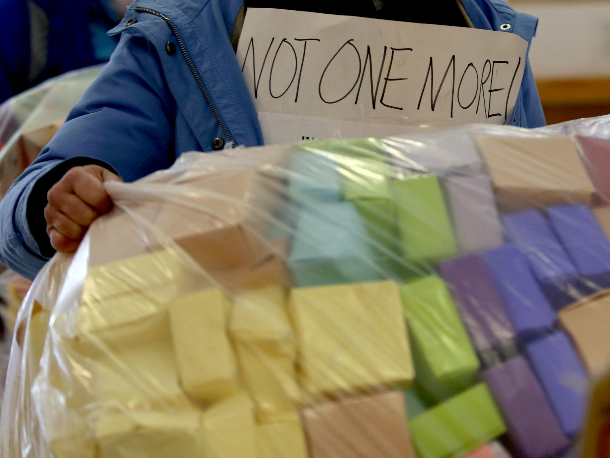 Carol Tenenbaum, of Portland, and others deliver and display more than 37,000 handmade origami boxes, representing victims of gun violence, at the Oregon State Capitol in Salem on Friday, Feb. 15, 2019. The Soul Box Project, started by Portland artist Leslie Lee, aims to reveal the enormity of the gun fire epidemic.