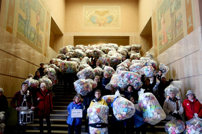 More than 100 people delivered some 37,000 handmade origami boxes, each representing a U.S. victim of gun violence, to the Oregon State Capitol in Salem on Friday, Feb. 15, 2019. The Soul Box Project, started by Portland artist Leslie Lee, was conceived to reveal the enormity of the gun-death epidemic.