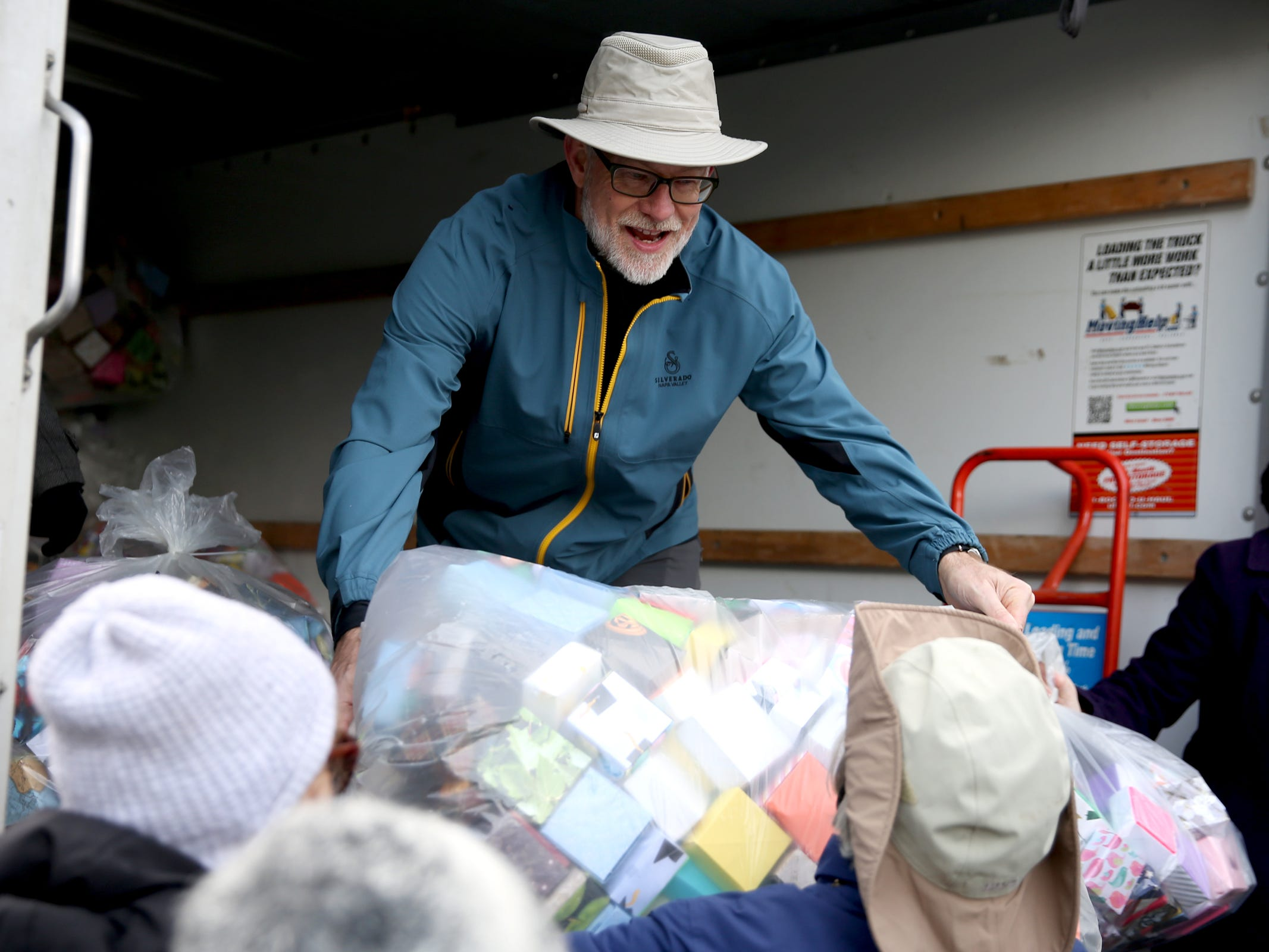 Richard Carroll of Lake Oswego, helps unload bags of 37,000 handmade origami boxes, representing victims of gun violence, that will be delivered and display at the Oregon State Capitol in Salem on Friday, Feb. 15, 2019. The Soul Box Project, started by Portland artist Leslie Lee, aims to reveal the enormity of the gun fire epidemic.