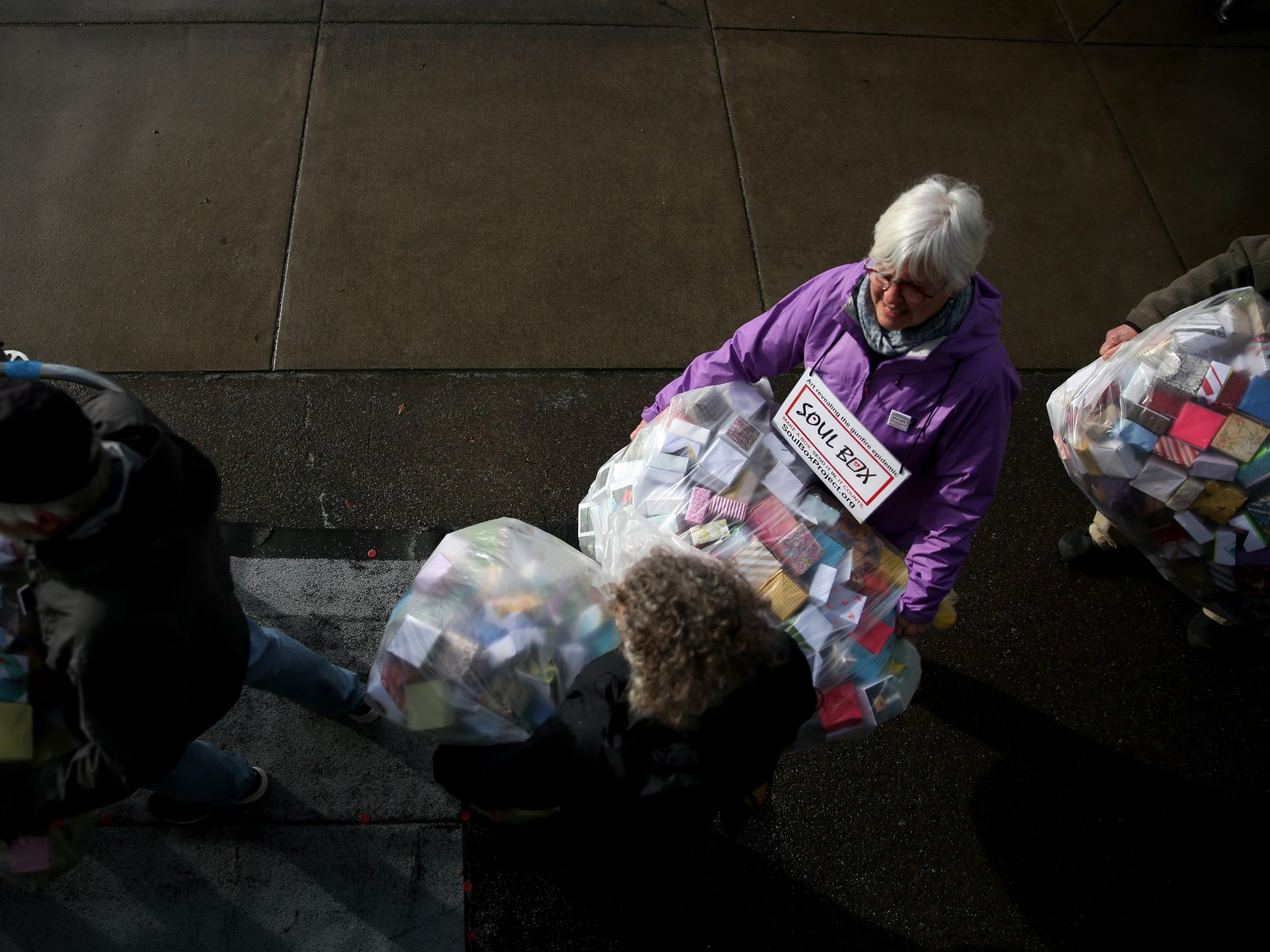 Sarah Newhall, of Portland, and others deliver and display more than 37,000 handmade origami boxes, representing victims of gun violence, at the Oregon State Capitol in Salem on Friday, Feb. 15, 2019. The Soul Box Project, started by Portland artist Leslie Lee, aims to reveal the enormity of the gun fire epidemic.