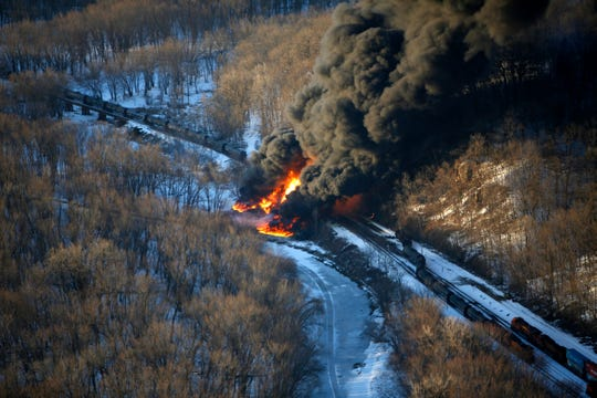 In this March 5, 2015, file photo, smoke and flames erupt from the scene of a train derailment near Galena, Ill.