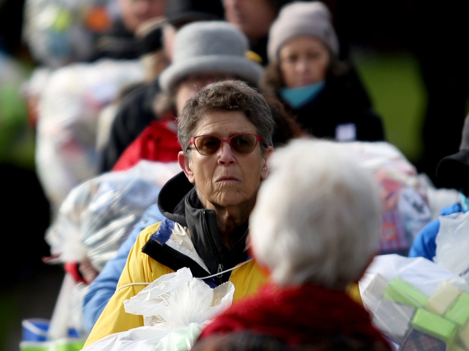 Ellen Goldberg, of Portland, and others deliver and display more than 37,000 handmade origami boxes, representing victims of gun violence, at the Oregon State Capitol in Salem on Friday, Feb. 15, 2019. The Soul Box Project, started by Portland artist Leslie Lee, aims to reveal the enormity of the gun fire epidemic.