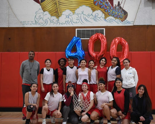 Coach Darren Jackson (top row, far left) has spent the last 19 years making the North Salinas girls' basketball program arguably the best in Monterey County.