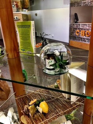 Nexcel CBD product sits on a table during the business's opening day Thursday, Feb. 14, 2019.