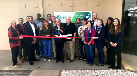 A ribbon cutting is held for Nexcel's opening day at 2510 S. Johnson Street Thursday, Feb. 14, 2019.