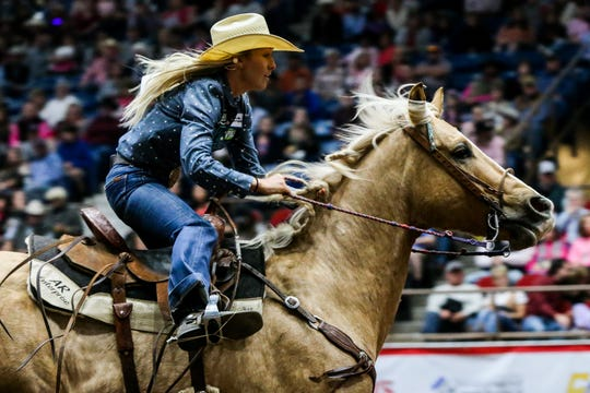 Sidney Forrest barrel races during the San Angelo Stock Show & Rodeo performance Thursday, Feb. 14, 2019, at Foster Communications Coliseum.