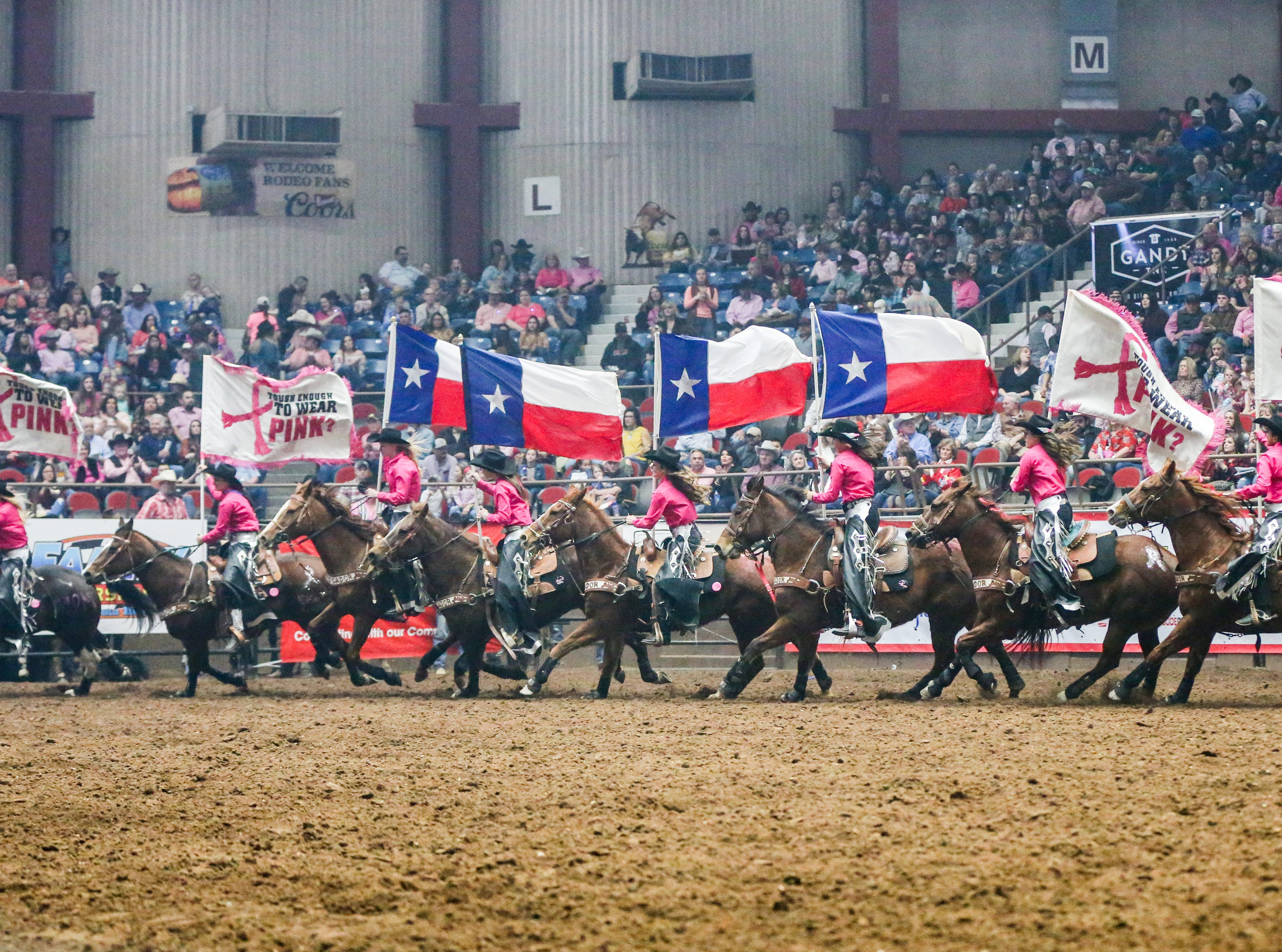 The San Angelo Ambassadors ride in the San Angelo Stock Show & Rodeo performance Thursday, Feb. 14, 2019, at Foster Communications Coliseum.