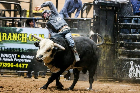 Bayle Worden rides a bull during the San Angelo Stock Show & Rodeo performance Thursday, Feb. 14, 2019, at Foster Communications Coliseum.