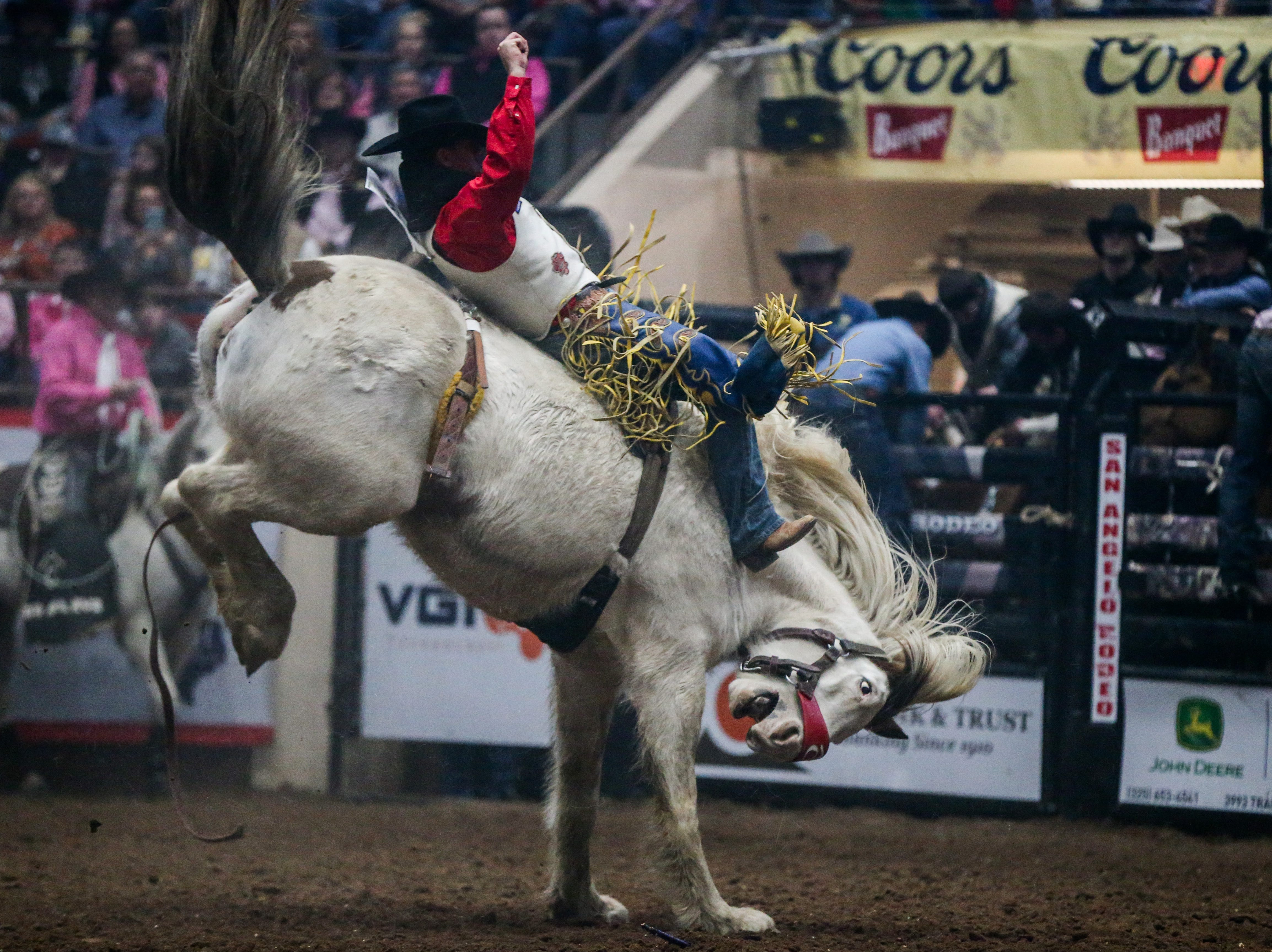 Jamie Howlett rides bareback during the San Angelo Stock Show & Rodeo performance Thursday, Feb. 14, 2019, at Foster Communications Coliseum.