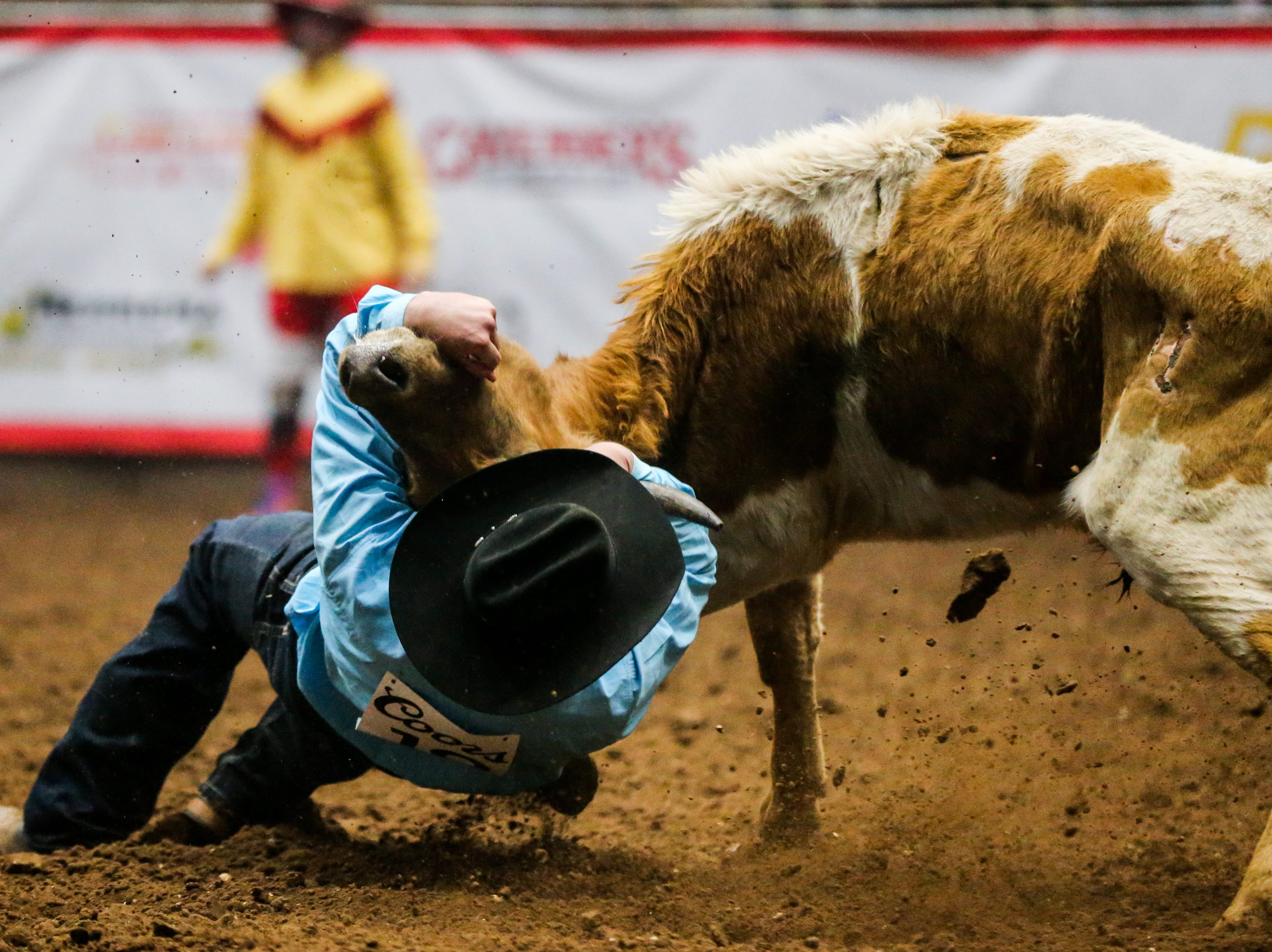 Bridger Anderson steer wrestle during the San Angelo Stock Show & Rodeo performance Thursday, Feb. 14, 2019, at Foster Communications Coliseum.