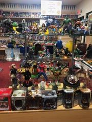 Action figures and other memorabilia offered at Winner's Circle, a new gaming and memorabilia store opening at 2410 Vanderventer Street on March 15.
