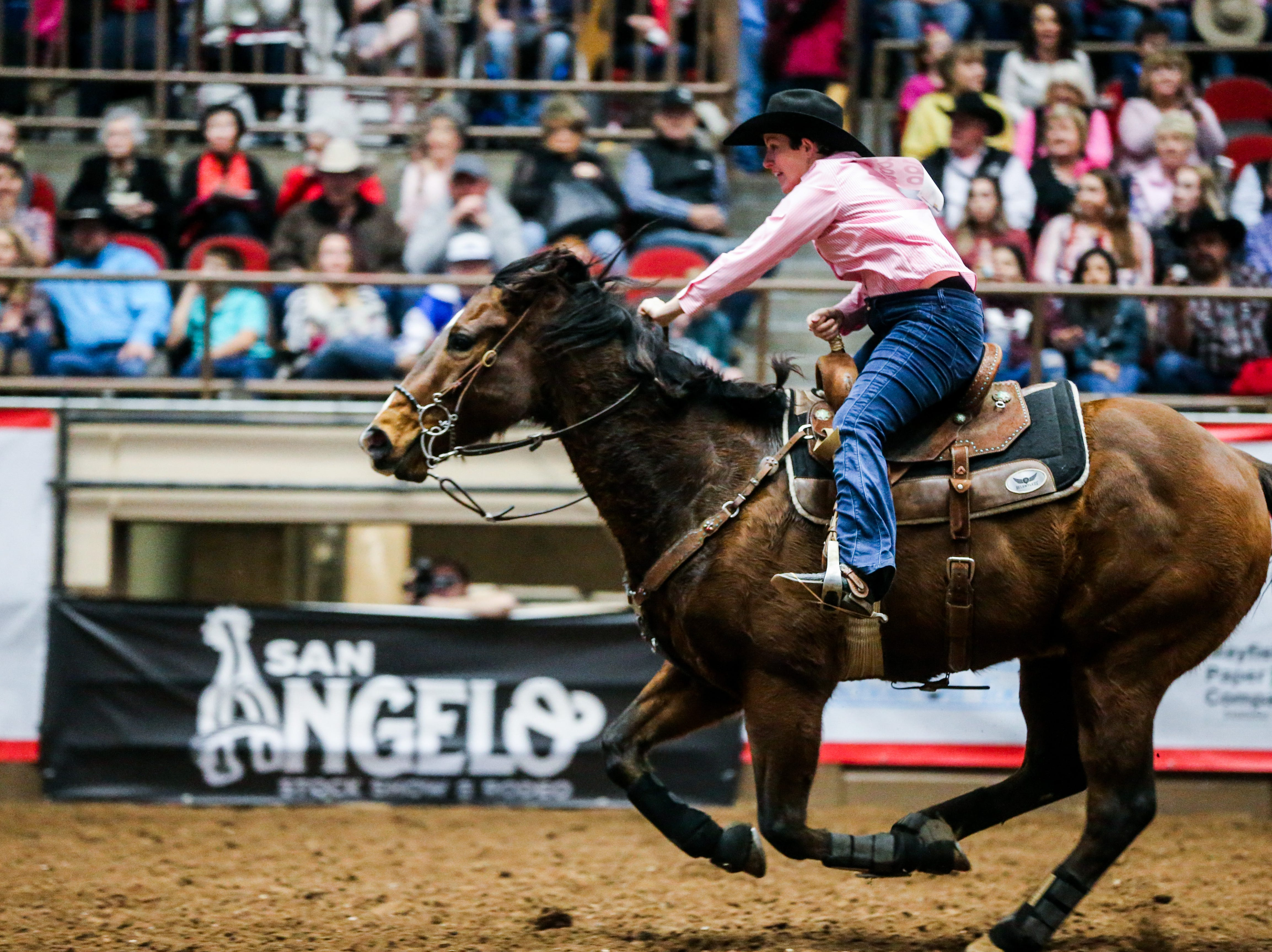 Jill Tanner barrel races during the San Angelo Stock Show & Rodeo performance Thursday, Feb. 14, 2019, at Foster Communications Coliseum.
