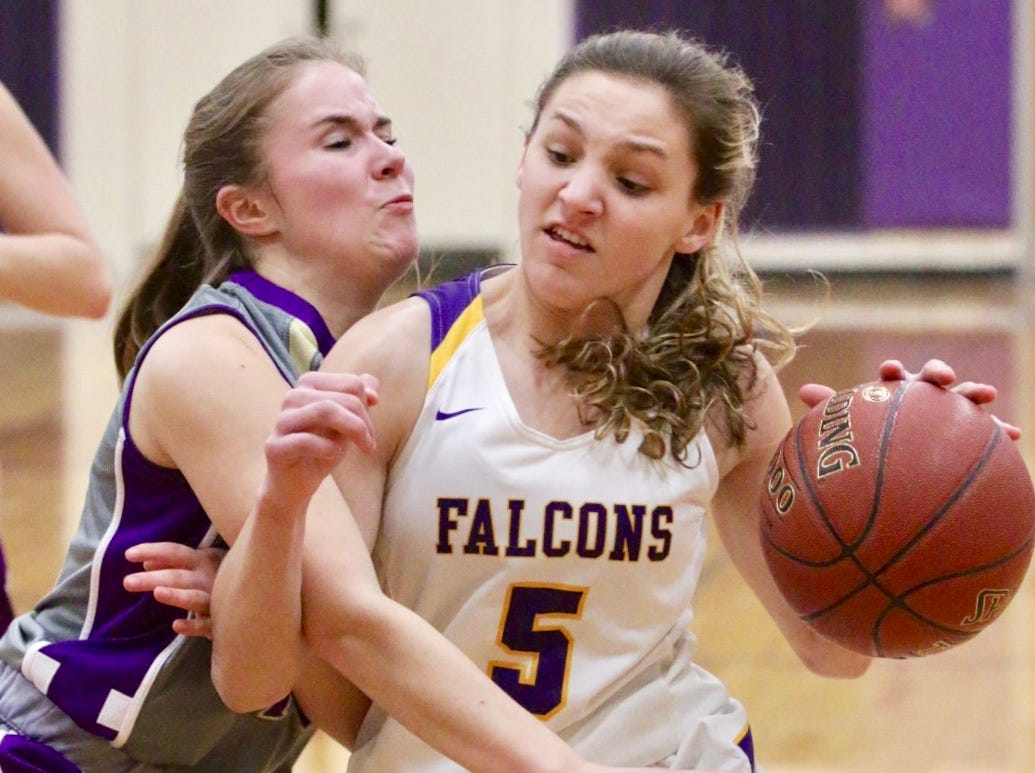 Sheboygan Falls' Madelaine Specht (5) is tangled up with a Two Rivers' player, Thursday, February 14, 2019, in Sheboygan Falls, Wis.