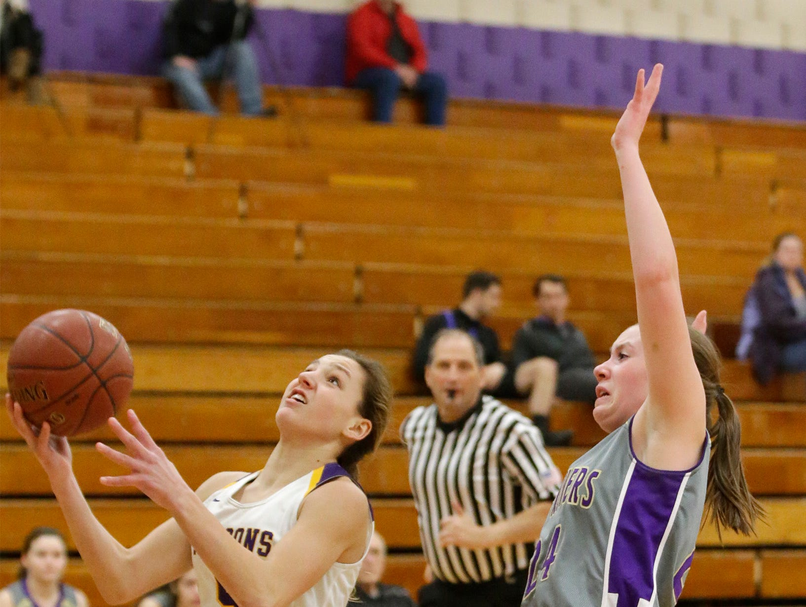 Sheboygan Falls' Madellaine (5) thrusts a shot to the rim against Two Rivers, Thursday, February 14, 2019, in Sheboygan Falls, Wis.