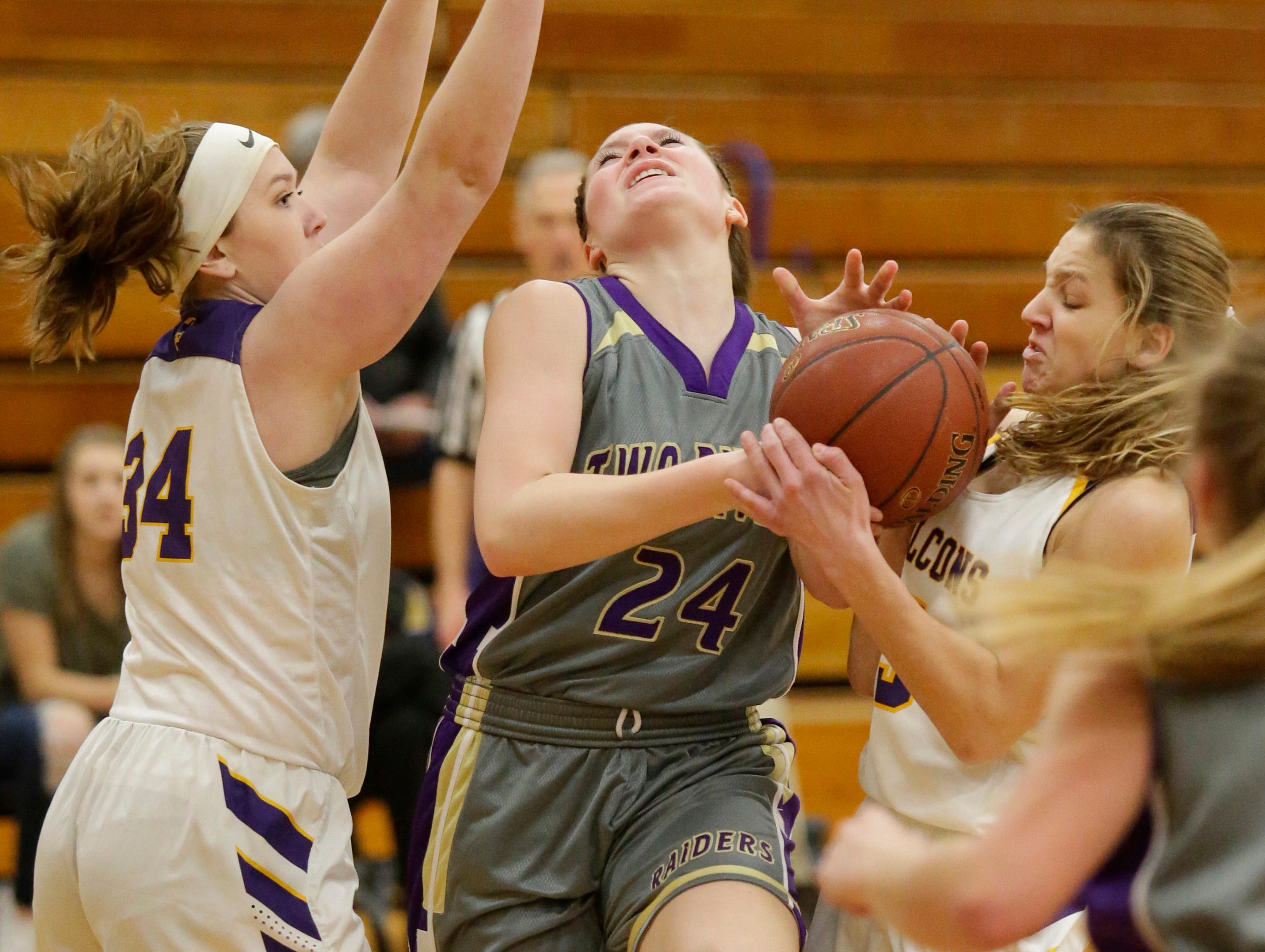 Two Rivers' Kiley Graff (24) struggles for the ball against Sheboygan Falls, Thursday, February 14, 2019, in Sheboygan Falls, Wis.