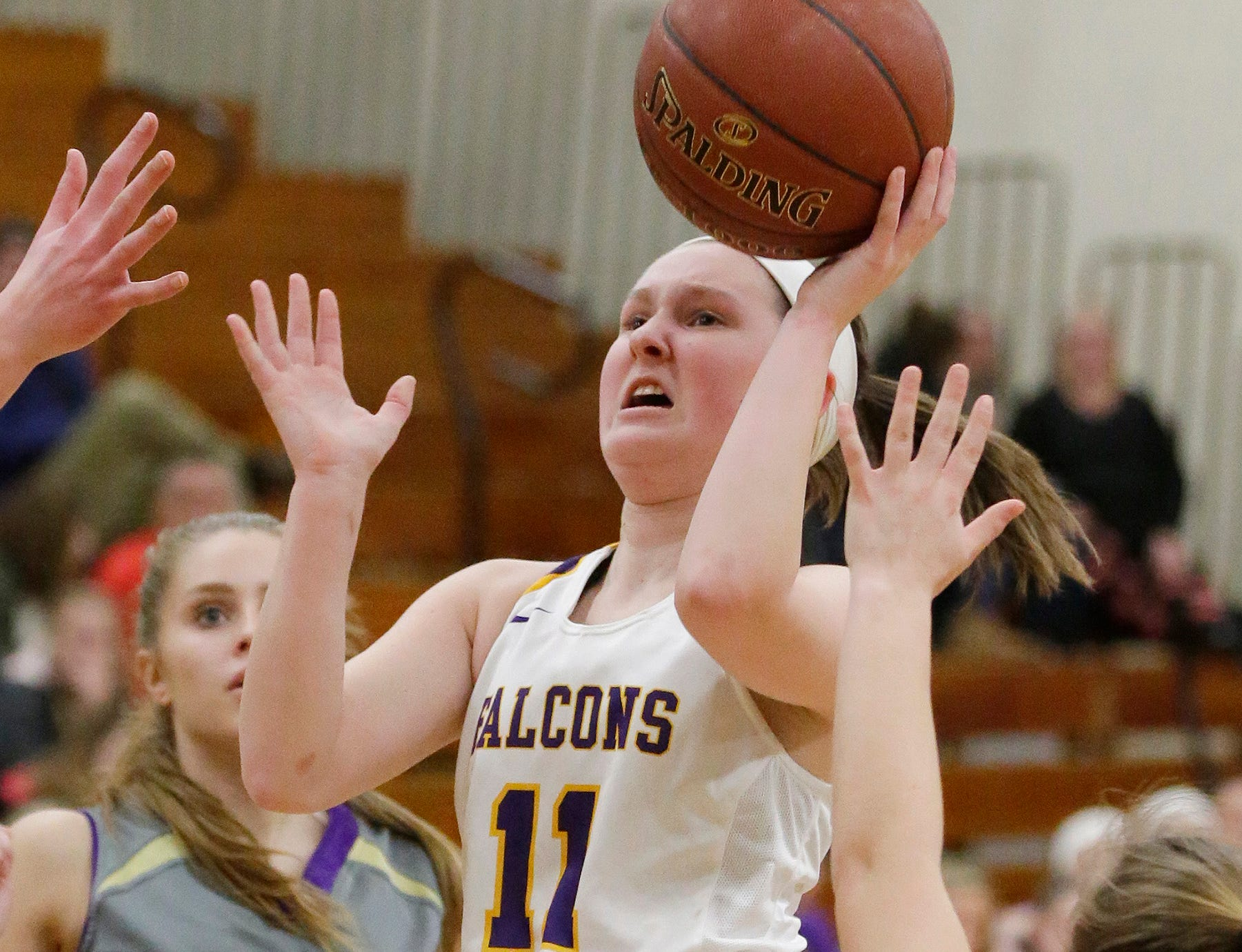 Sheboygan Falls' Claire Smallwood (11) launches a shot against Two Rivers, Thursday, February 14, 2019, in Sheboygan Falls, Wis.