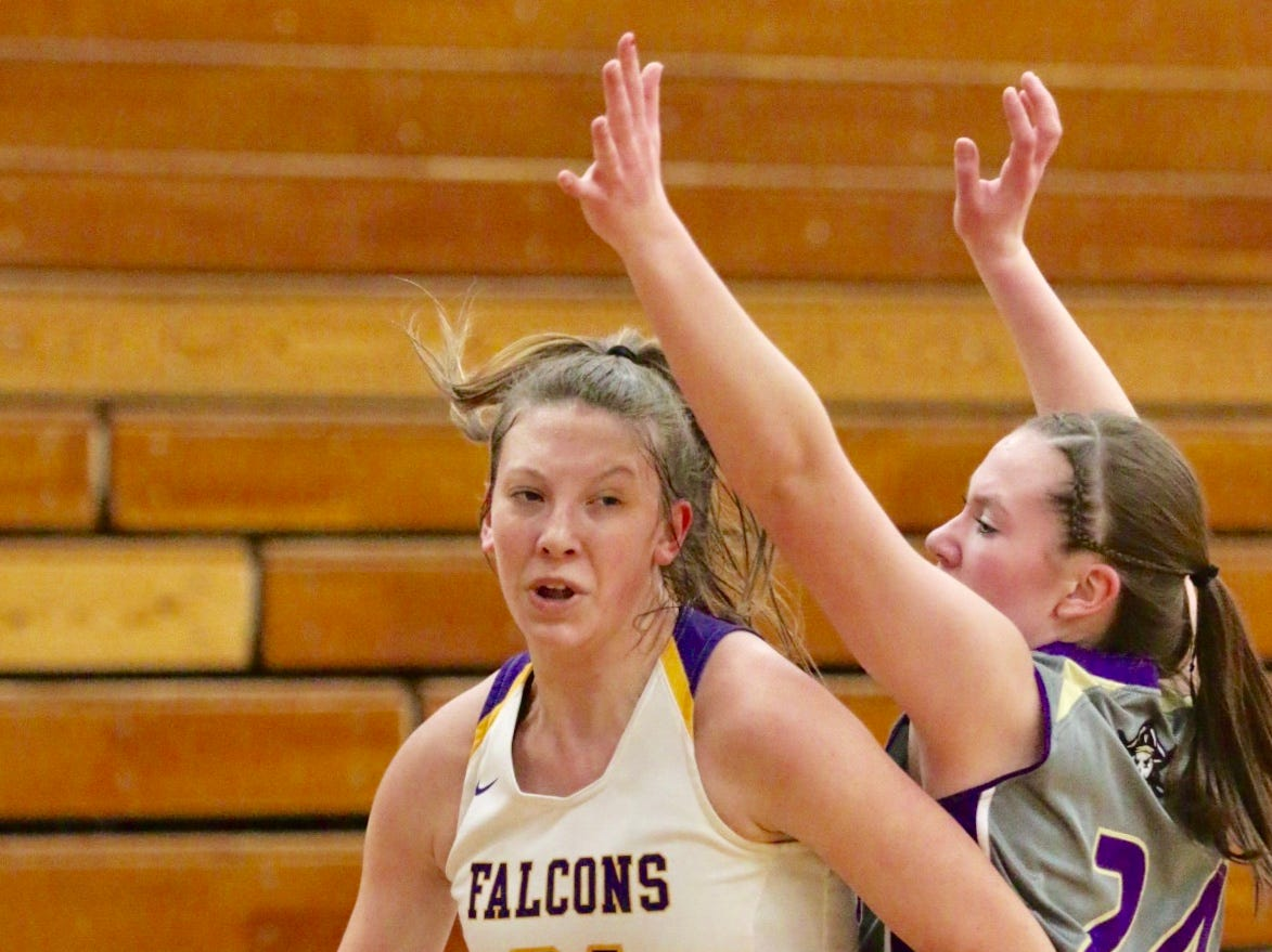 Sheboygan Falls' Emma Wollert (31) drives the ball around Two Rivers' Kiley Graff (24), Thursday, February 14, 2019, in Sheboygan Falls, Wis.