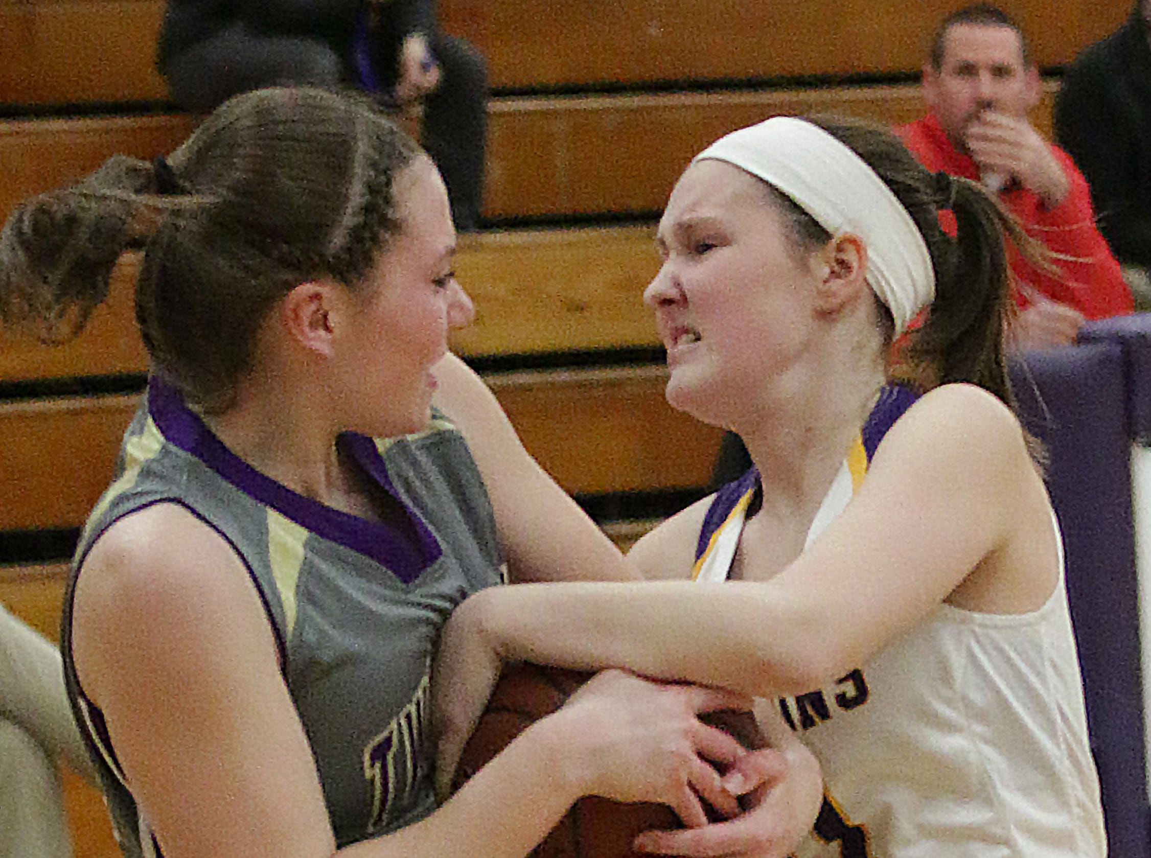 Two Rivers' Kiley Graff (lefft, and Claire Smallwood (11) battle for the ball, Thursday, February 14, 2019, in Sheboygan Falls, Wis.