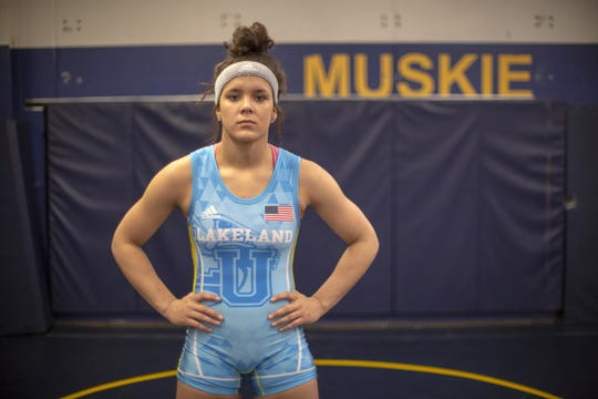 Jayden Laurent poses in the wrestling room at Lakeland University in Plymouth.